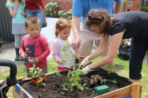 kids-gardening-with-mother