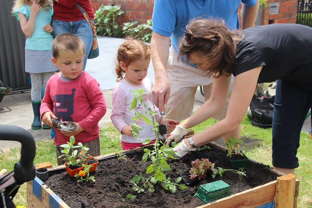 kids gardening with mother