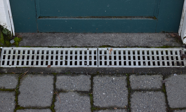 A channel drain to address drainage problems